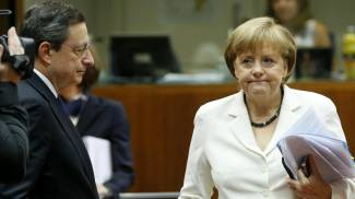 Draghi e Merkel (Ansa)