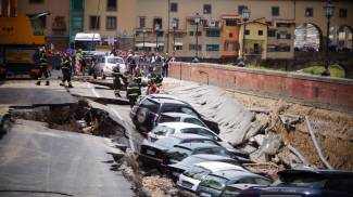 Road collapses along Florence's Arno river. Twenty cars swallowed up by the mud