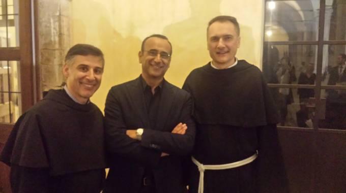 Carlo Conti da Assisi stasera Con il Cuore, nel nome di Francesco
