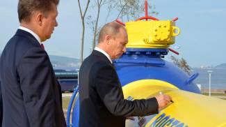 Vladimir Putin col CEO di Gazprom, Alexei Miller (Reuters)