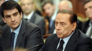 Raffaele Fitto e Silvio Berlusconi (Ansa)