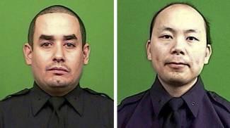 I due poliziotti, Rafael Ramos e Wenjian Liu, uccisi a New York (Ansa)